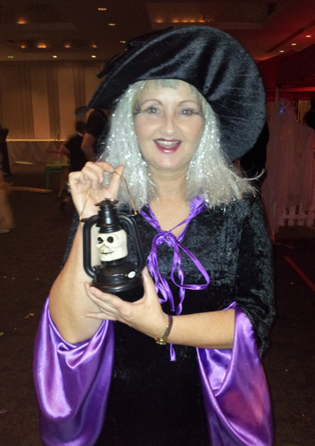 photo of glamorous witch at Halloween party