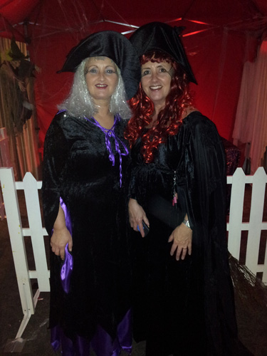 photo of two glamorous witches at Halloween party